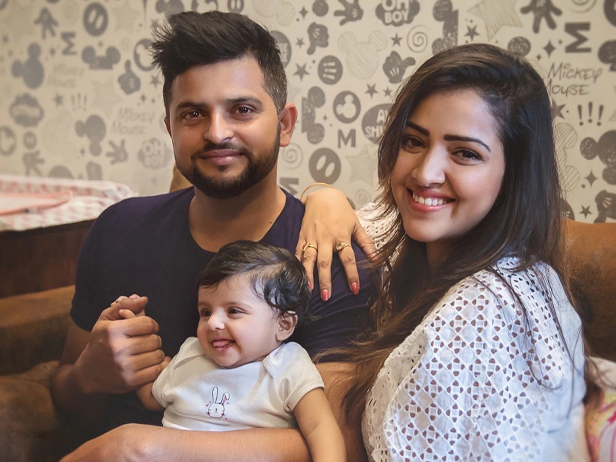 Suresh Raina with his wife and daughter