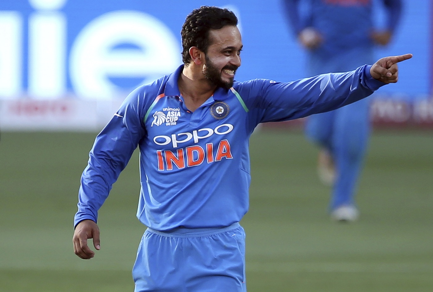 Kedar Jadhav is overjoyed after he gets a wicket Associated Press