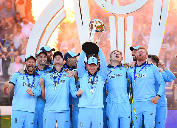 Eoin Morgan of England celebrates with his team as he lifts the Cricket World Cup trophy after the Final of the ICC Cricket World Cup 2019 between New Zealand and England at Lord's Cricket Ground on July 14, 2019 in London, England. (Photo by Clive Mason/Getty Images)