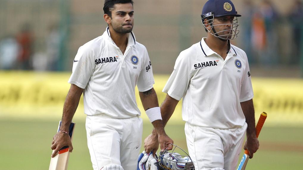 Virat Kohli will captain his first Test match for India starting on Tuesday with MS Dhoni, right, unable to play against Australia. Aijaz Rahi / AP Virat Kohli will captain his first Test match for India starting on Tuesday with MS Dhoni, right, unable to play against Australia. Aijaz Rahi / AP