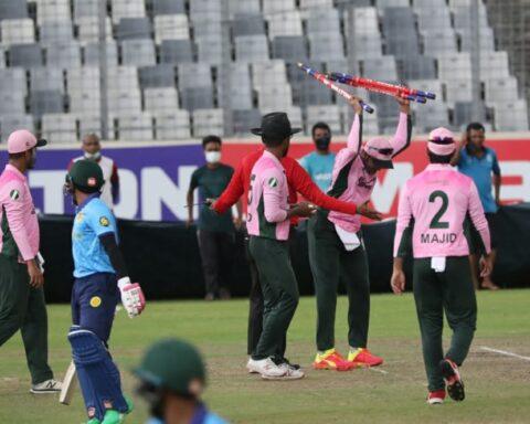 Shakib Al Hasan flings the stumps after umpire Mahfuzur Rahman calls for the covers Walton