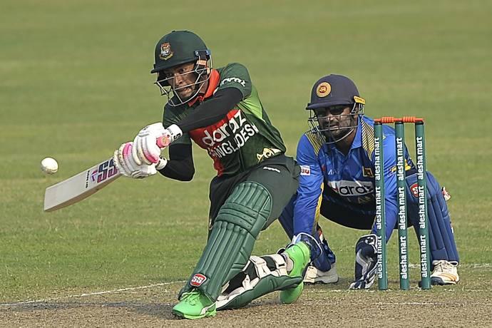 Mushfiqur Rahim plays a shot against Sri Lanka. - AFP