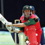 Zimbabwe captain Andy Flower prepares to reverse sweep ©Reuters