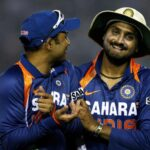 IMAGE: Virender Sehwag (left) and Harbhajan Singh share a laugh during an ODI against Australia in Mohali in November 2009. Photograph: Mark Kolbe/Getty Images