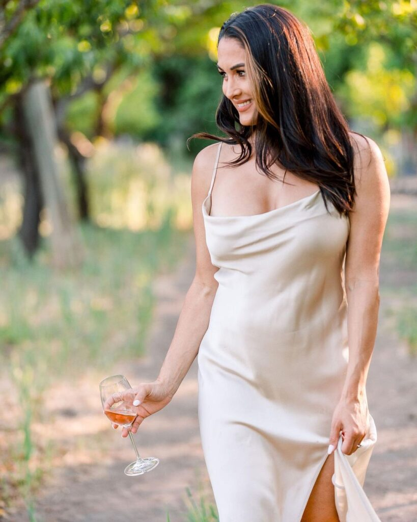 Nikki Bella Poses As White Wine Lover In Stunning Photos Ahead Of WWE Collaboration 37