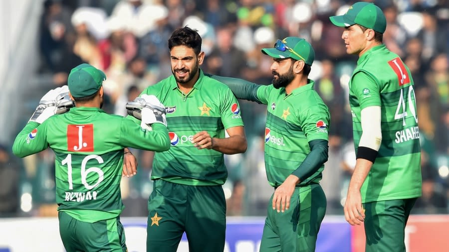 Haris Rauf celebrates a wicket with his team-mates AFP via Getty Images