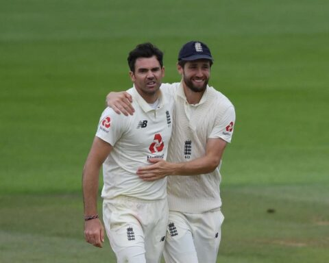A snarling James Anderson is congratulated on his five-fer by Chris Woakes (Getty)