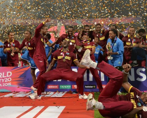 West Indies players celebrate with the T20 WC Trophy [Image-Getty]