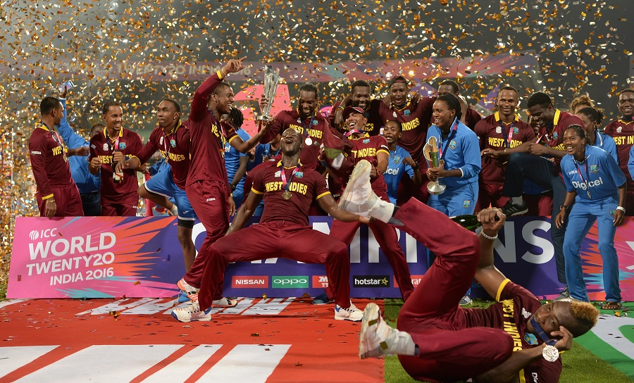 West Indies players celebrate with the 2016 T20 WC Trophy [Image-Getty]